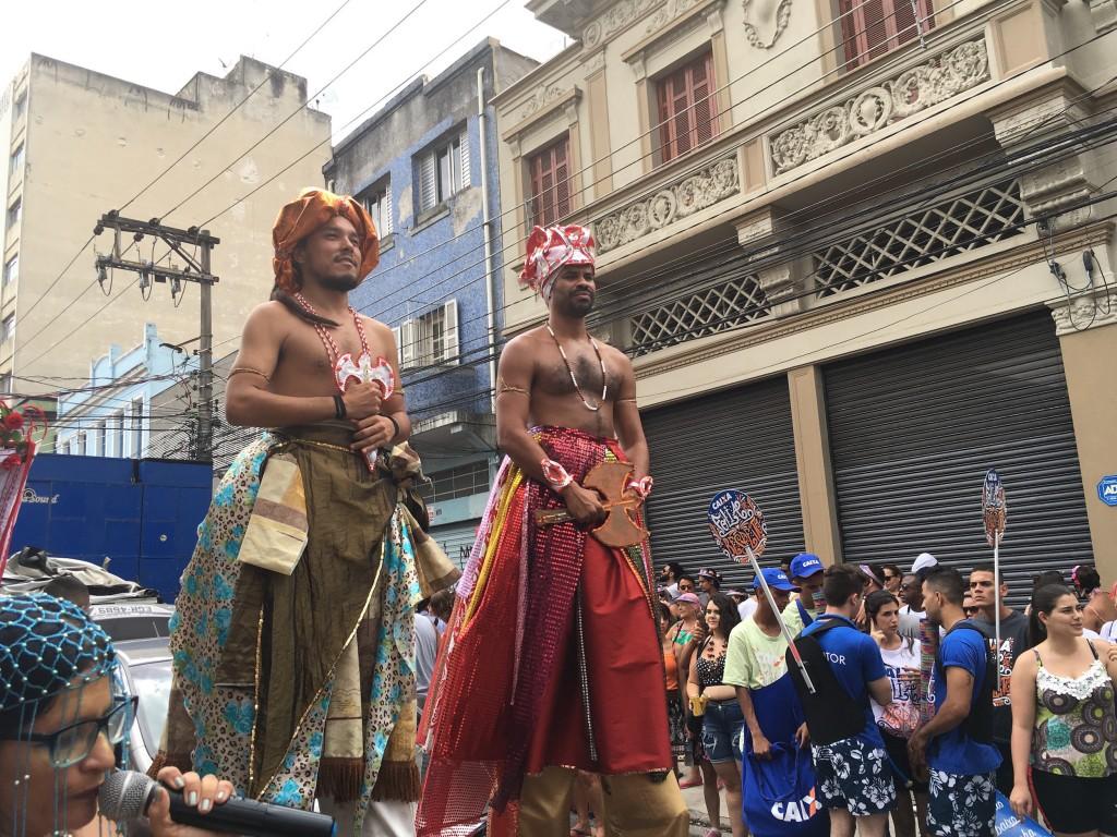 Men participate in stilts in the Ilu Oba de Min Carnival group © Lise Alves