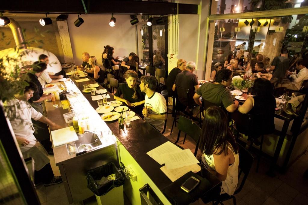Notice the tabun on the left side of the edge of the bar? Tel Aviv's Santa Katarina's menu revolves around the ancient stone oven | Tamuz Rachman ©, courtesy of Santa Katarina