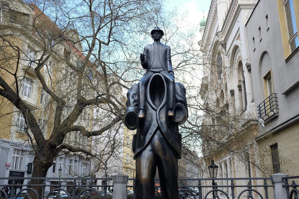 Bronze statue of Franz Kafka in Dusni Street, in Prague's historic Jewish Quarter, by the artist Jaroslav Rona | © J Morc / Shutterstock