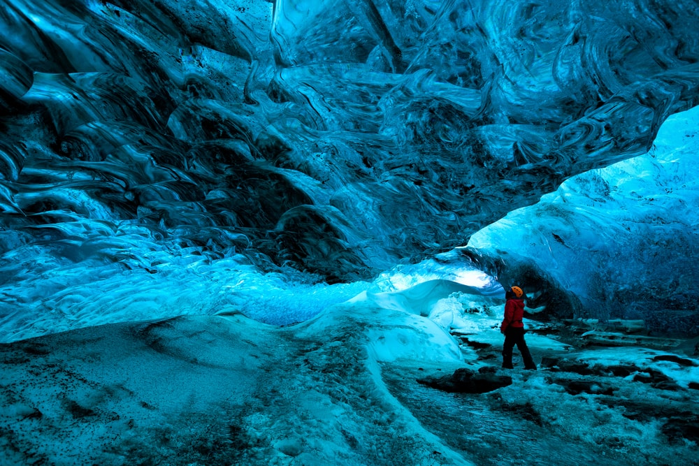 Explorer inside an ice cave, Vatnajokull n National Park, Iceland | © Bill45/Shutterstock