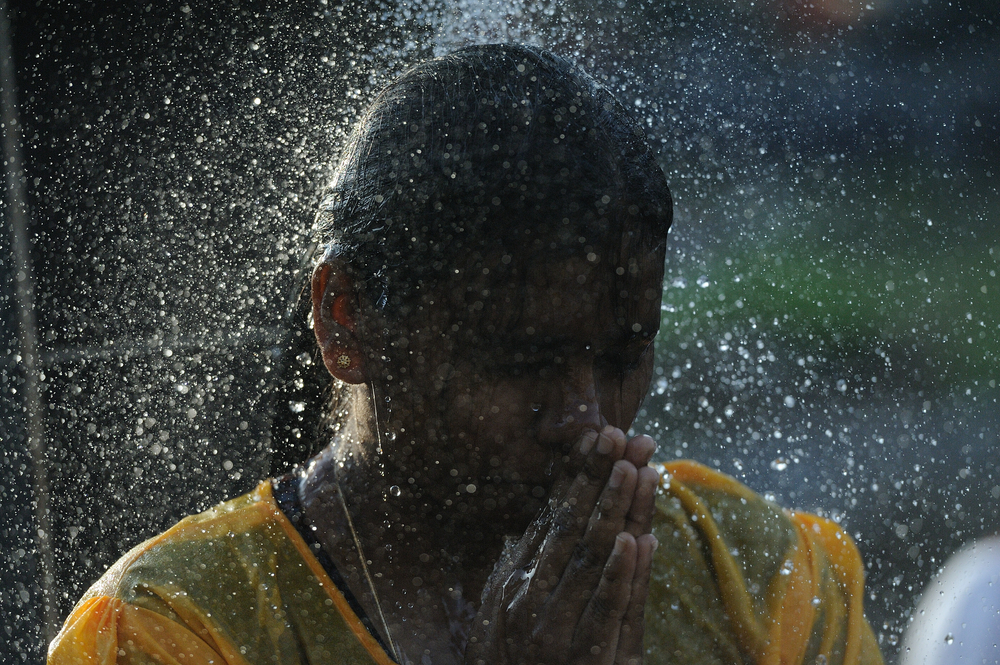 This woman has a shower as part of the Festival, to fulfill her vows and offer thanks to the gods | © AMRUL AZUAR MOKHTAR / Shutterstock