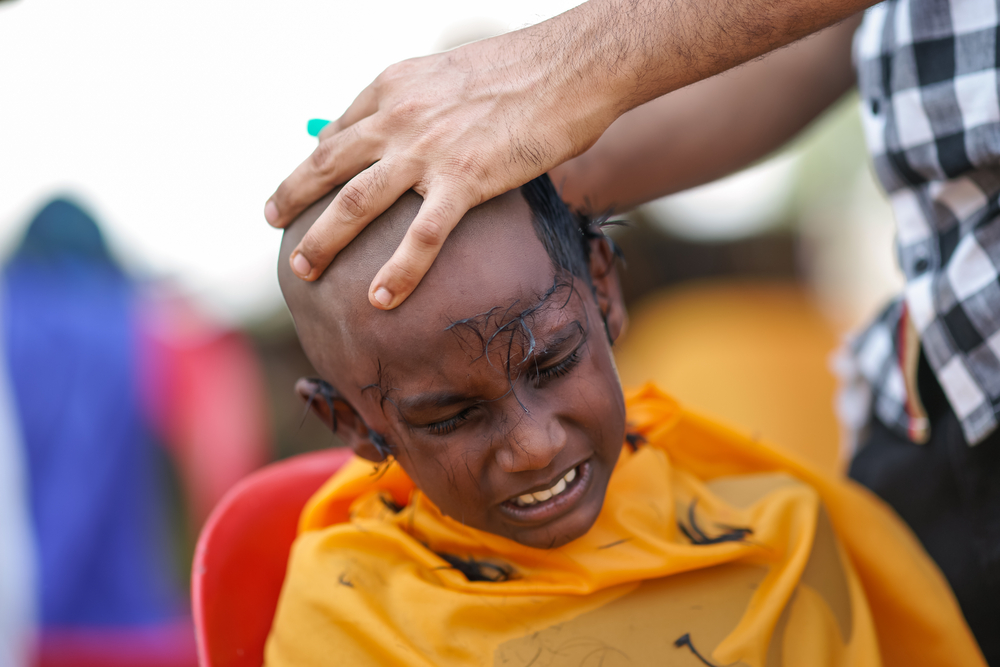 This boy is having his head shaved for the Festival | © yushussain / Shutterstock