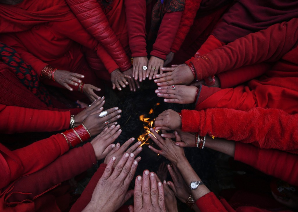A group of Nepalese Hindu devotees warm themselves after taking holy bath ©NARENDRA SHRESTHA/EPA/REX/Shutterstock