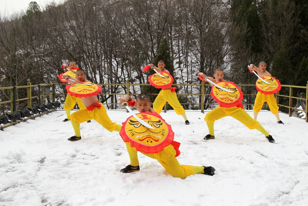 Monks practice Kung Fu in the snow, Shaolin Monastery, Dengfeng, central China | © Sipa Asia/REX/Shutterstock (8422527g) Monks practice Kung Fu in snow at Shaolin Monastery in Song Mountain Dengfeng, central China's Henan Province. The Monks of Shaolin Temple practice Kung Fu every day regardless of the weather. The youngest is just 6 years old. Monks practice Kung Fu in the snow, Shaolin Monastery, Dengfeng, central China - 22 Feb 2017