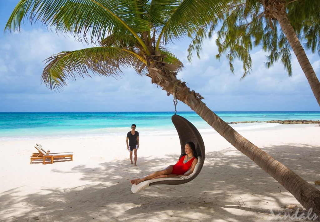 Rest beneath the shade of tropical palm and enjoy the gentle ocean breezes | Courtesy of Sandals Barbados