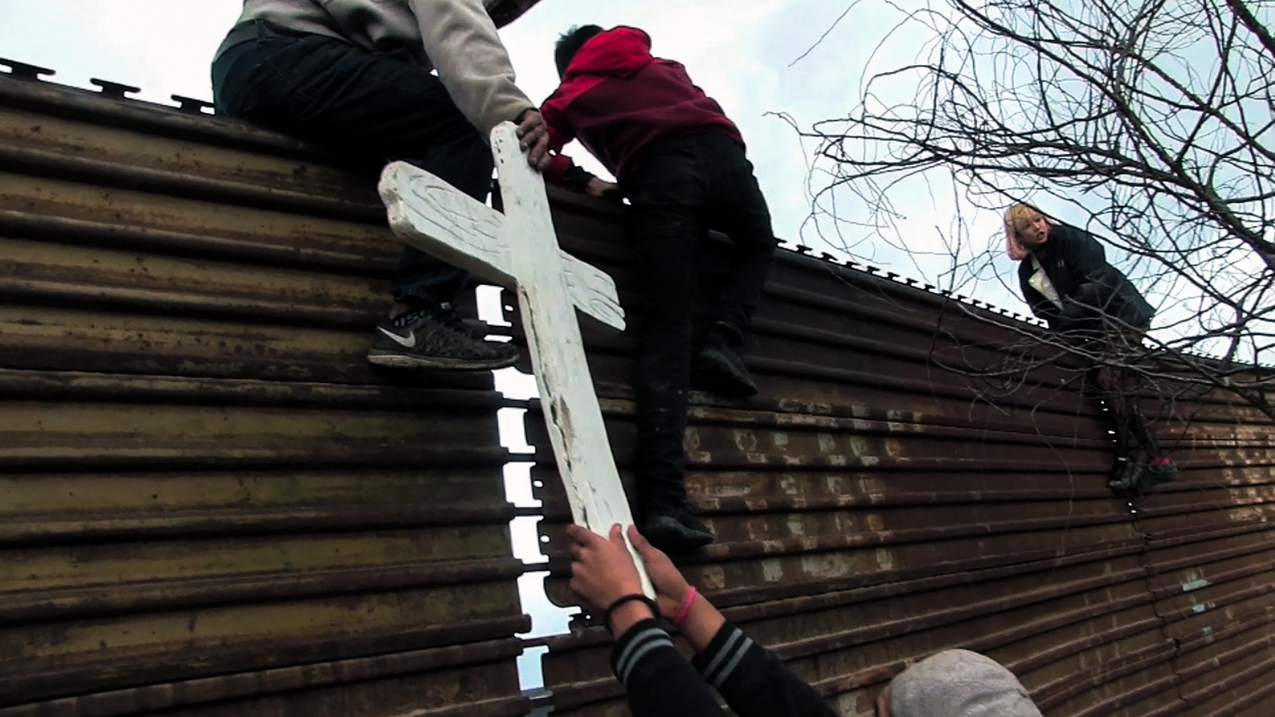 """Chim↑Pom, forming Team Libertad with the local residents and children, installed an object comprised of a hole, a cross labeled """"Libertad"""" and a shovel all made of plastic to pair up with The Grounds 