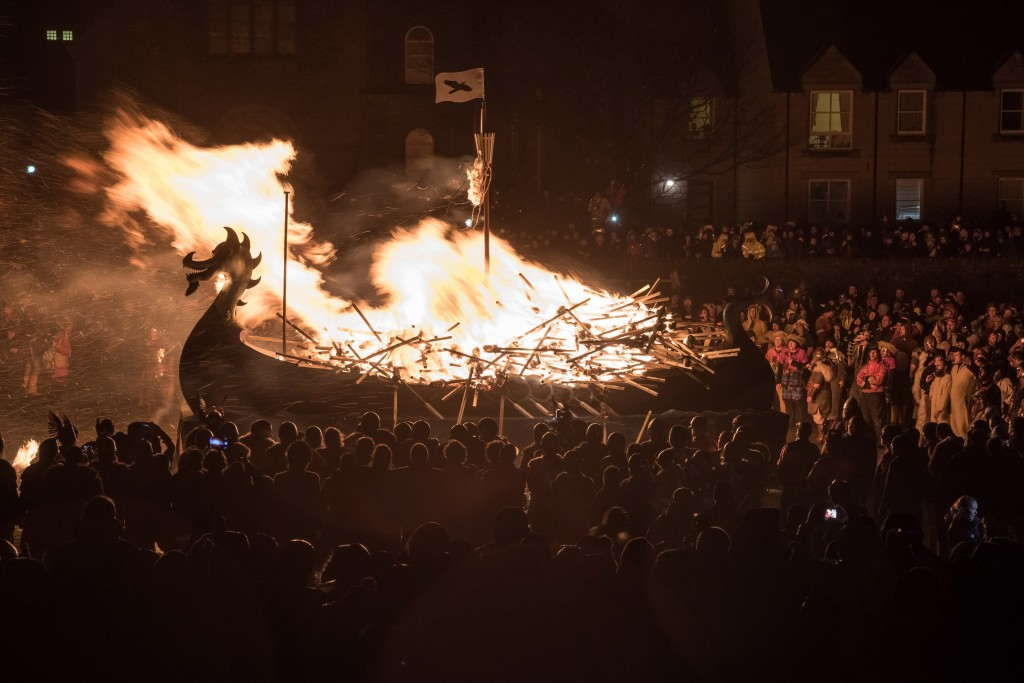 The galley Falcon is set ablaze by the guizers flaming torches | ©Austin Taylor / VisitScotland