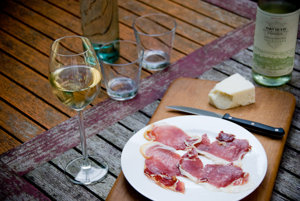 A selection of meats and wine © Taco Ekkel