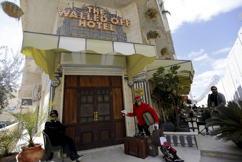 A view of the entrance of British street artist Banksy's Walled Off Hotel in the West Bank city of Bethlehem, 04 March 2017   Photo by ABED AL HASHLAMOUN/EPA/REX/Shutterstock