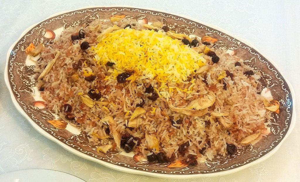 Âlbâloo polo is a sweet rice dish   © SaMin SAmIN / Wikimedia Commons
