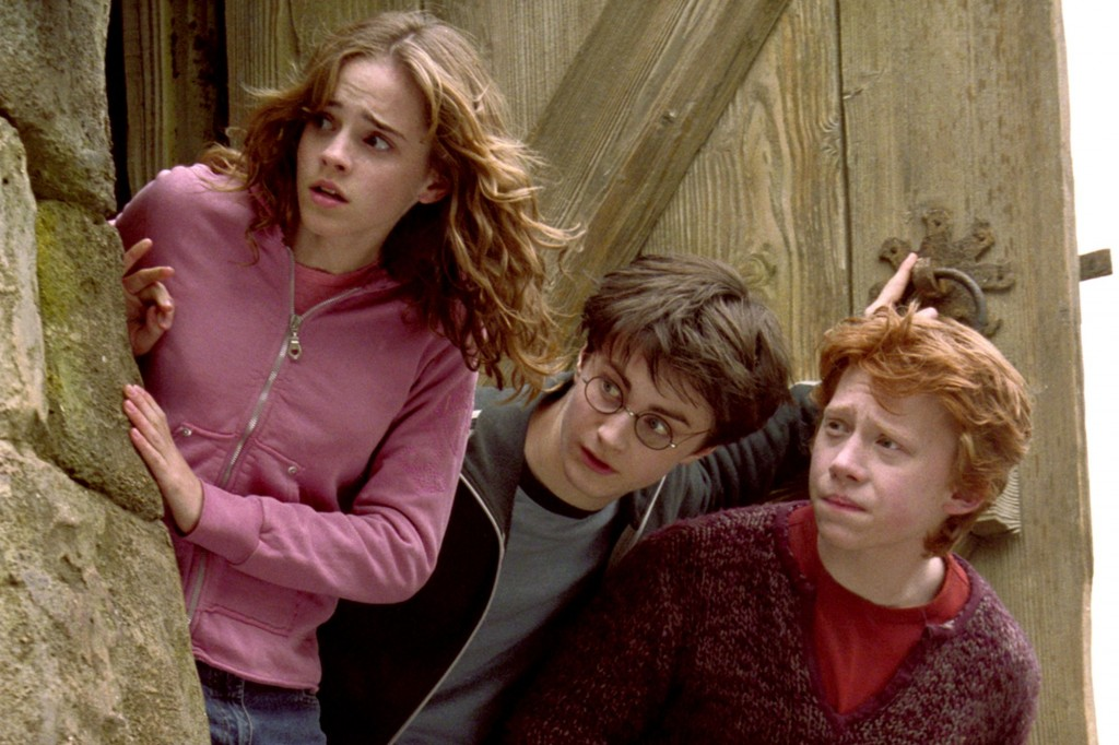 'Harry Potter and the Prisoner of Azkaban' (2004) Emma Watson as Hermione Granger, Daniel Radcliffe as Harry Potter, Rupert Grint as Ron Weasley | © Warner Bros.