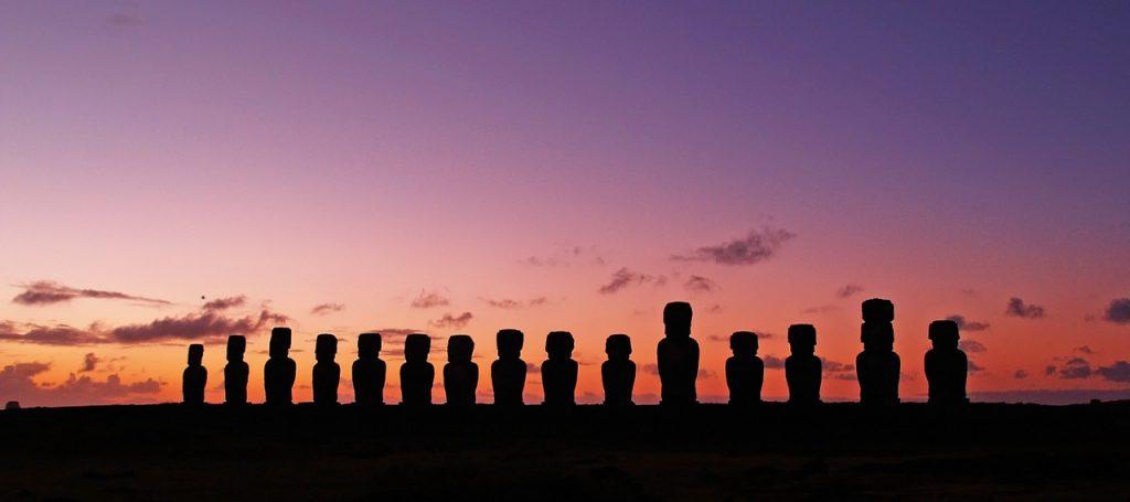 "<a href=""https://pixabay.com/en/chile-easter-island-rapa-nui-moai-1477188/"">The sun setting over the moai | © myeviahes/Pixabay</a>"