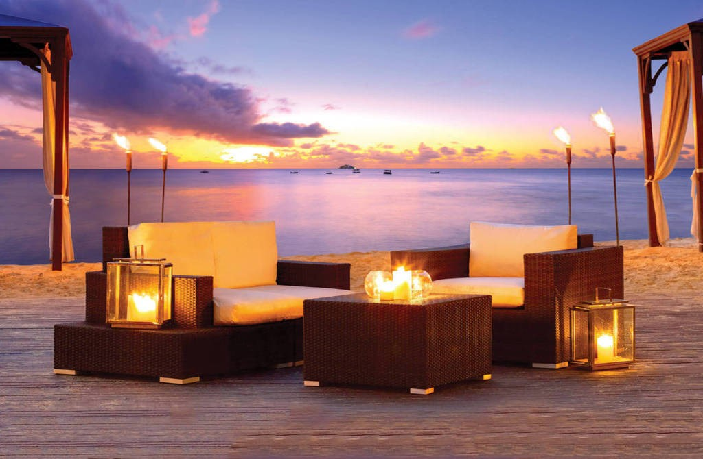 Candlelit Beachside Tables | Courtesy of The House by Elegant Hotels