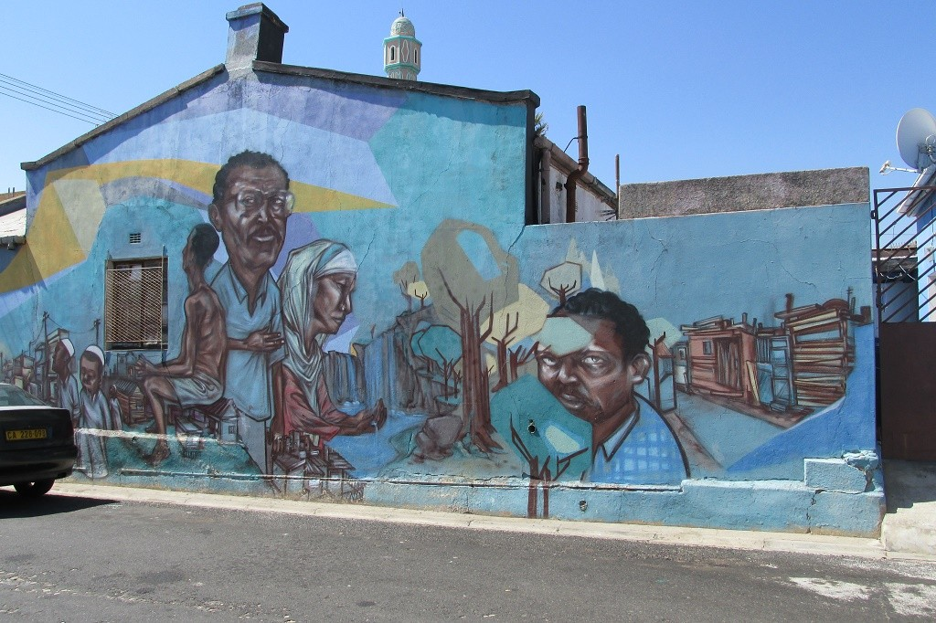 A mural painted on the side of a house © Lee-Shay Collison