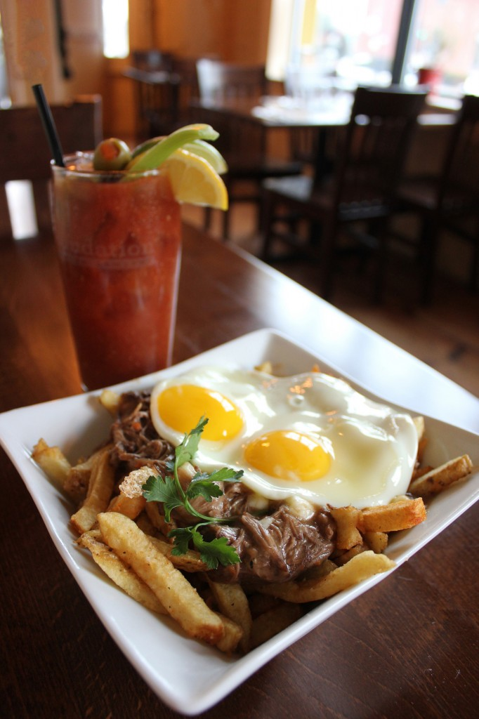 Poutine and Eggs with a Bloody Mary, Courtesy of Little Tap House