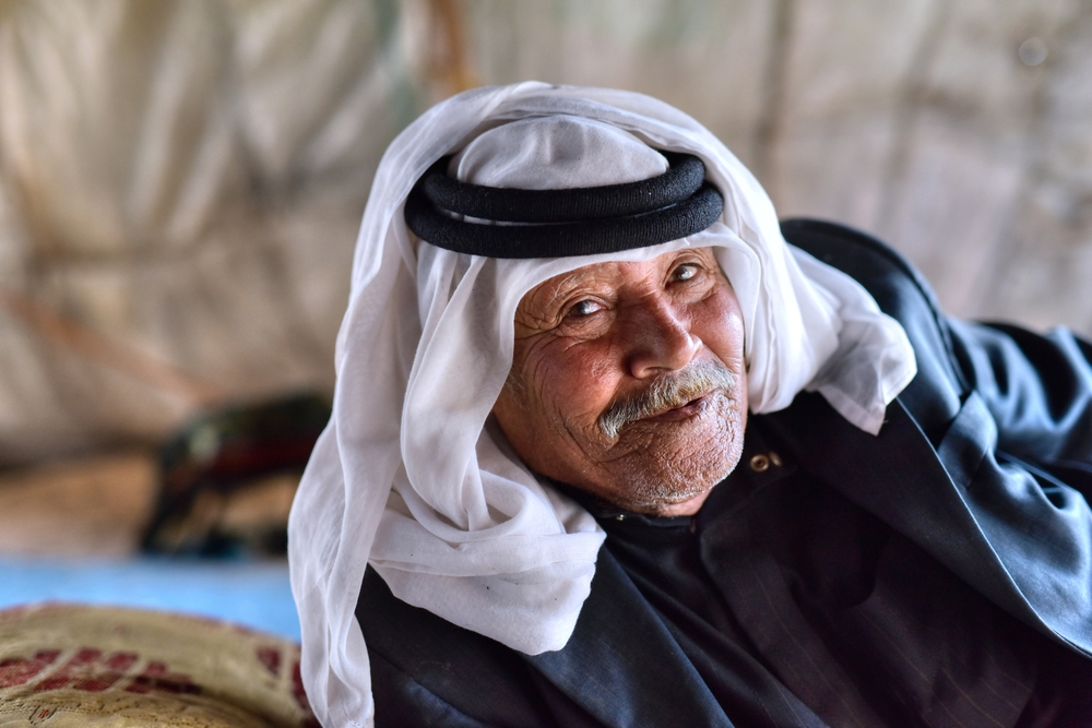 WADI MUSA - JORDAN / 08.05.2016: Portrait pf the an old bedouin from Jordan in his traditional tent © akturer