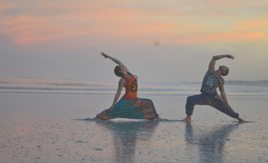 Yoga on the beach © Courtesy of SKA Clothing
