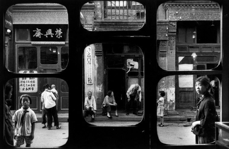 Marc Riboud, CHINA 1965. A street in Beijing as seen from inside an antique dealer's shop   © Marc Riboud/Courtesy of Magnum (London)