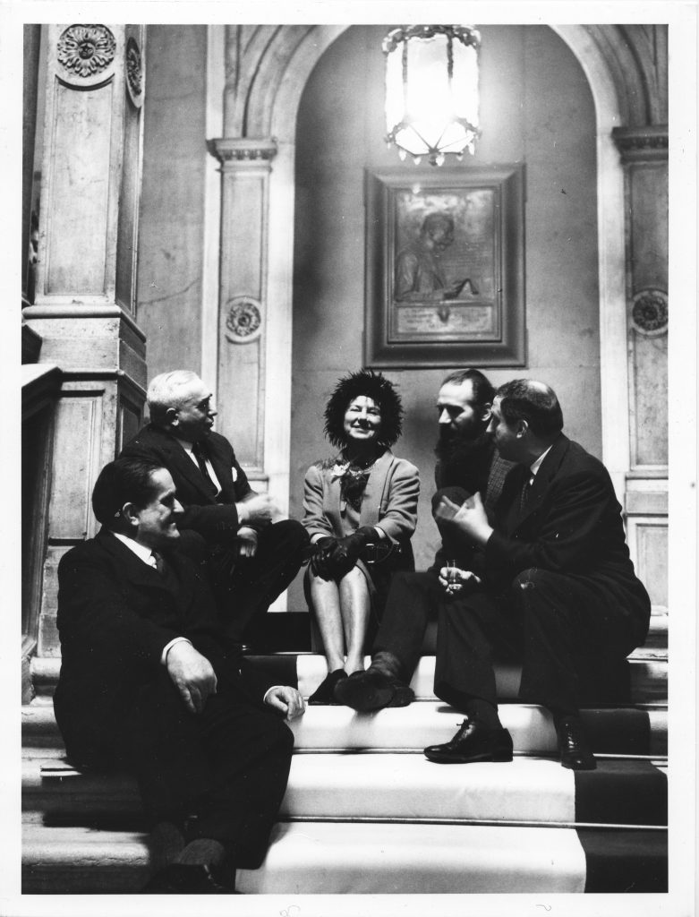 Giuseppe Marchiori, Giovanni Comisso, Peggy Guggenheim, Emilio Vedova and Giuseppe Santomaso on the staircase of the Venice City Hall, on the day Peggy was named Honorary Citizen of Venice; February 5, 1962. Solomon R. Guggenheim Foundation. Photo Archivio CameraphotoEpoche. Gift, Cassa di Risparmio di Venezia, 2005