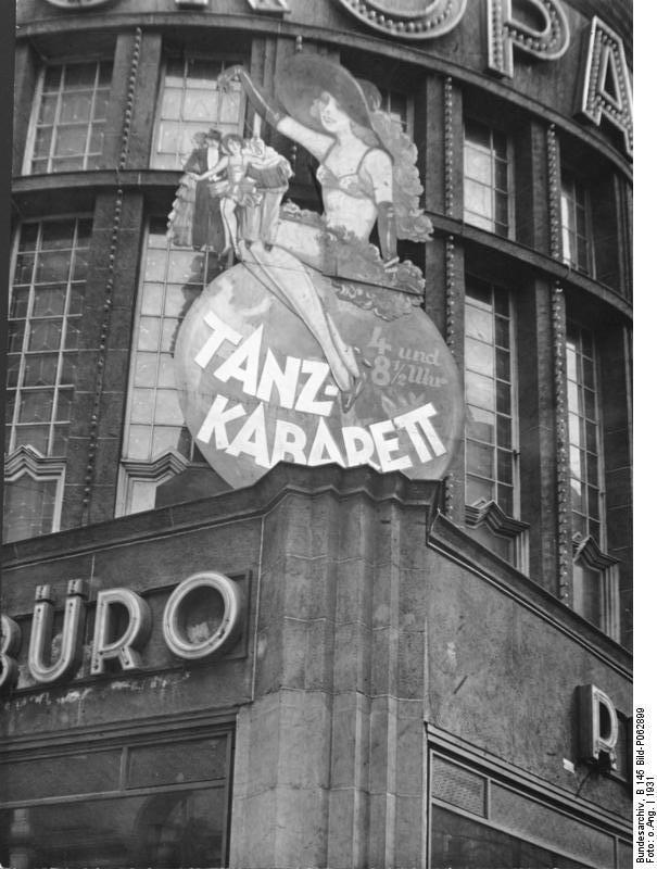 "<a href=""https://en.wikipedia.org/wiki/File:Bundesarchiv_B_145_Bild-P062899,_Berlin,_Tanzkabarett_im_Europahaus.jpg"">The Europahaus, one of hundreds of cabarets in Weimar Berlin, 1931 | © Wikimedia Commons</a>"
