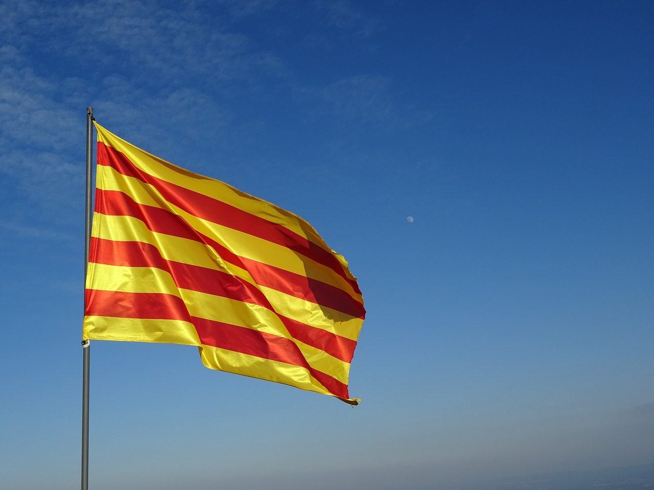 "<a href=""https://pixabay.com/en/flag-catalan-senyera-waving-2123796/"">The Catalan flag 