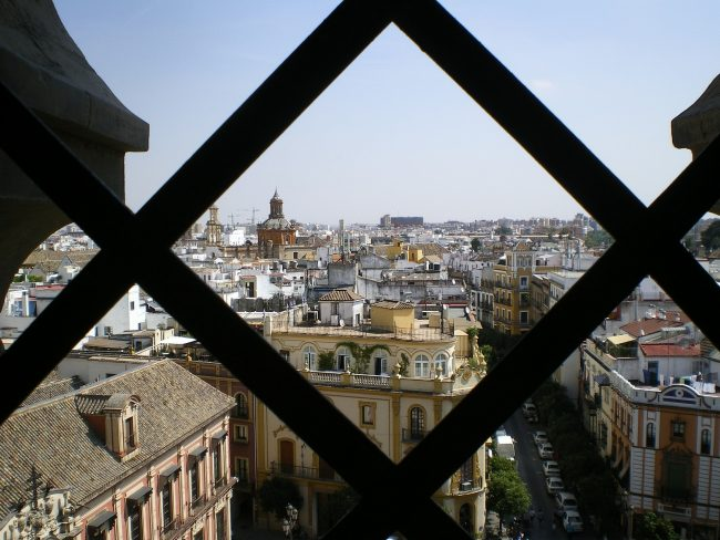 """<a href=""""https://pixabay.com/en/giralda-views-seville-cathedral-629991/"""">View from the top of Seville's iconic Giralda belltower   © AlmudenaCuesta/Pixabay</a>"""
