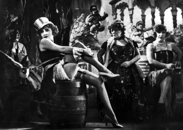 """<a href=""""https://en.wikipedia.org/wiki/Weimar_culture#/media/File:Marlene_Dietrich_in_The_Blue_Angel.png"""">A publicity photograph for the film <i>Der Blaue Engel</i> (The Blue Angel) 1930, featuring Marlene Dietrich 
