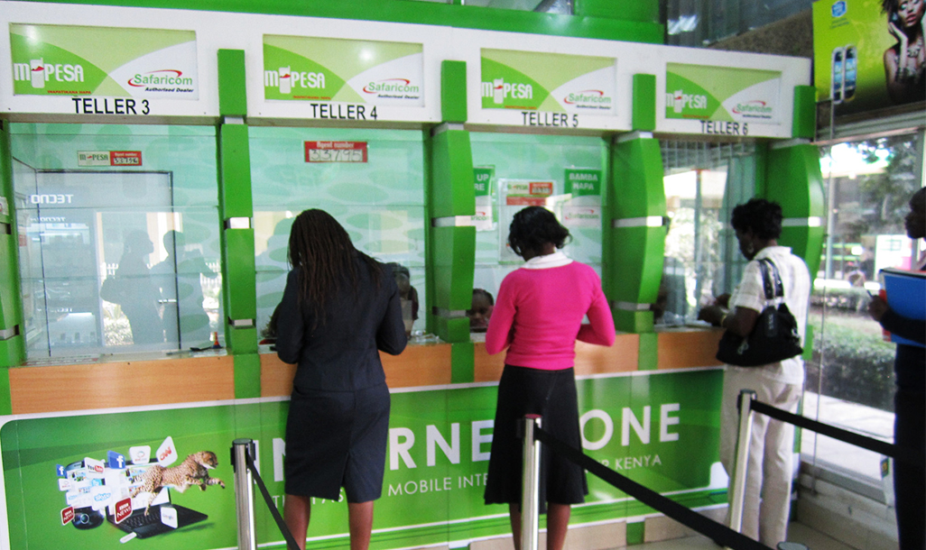 People paying through Mpesa | © Ivan Small/Flickr