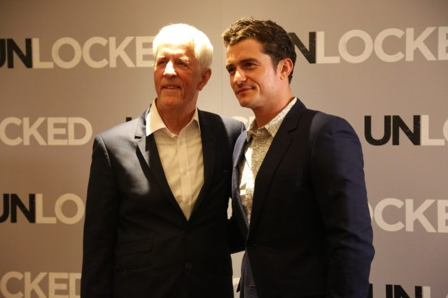 Michael Apted and Orlando Bloom   © Lionsgate UK