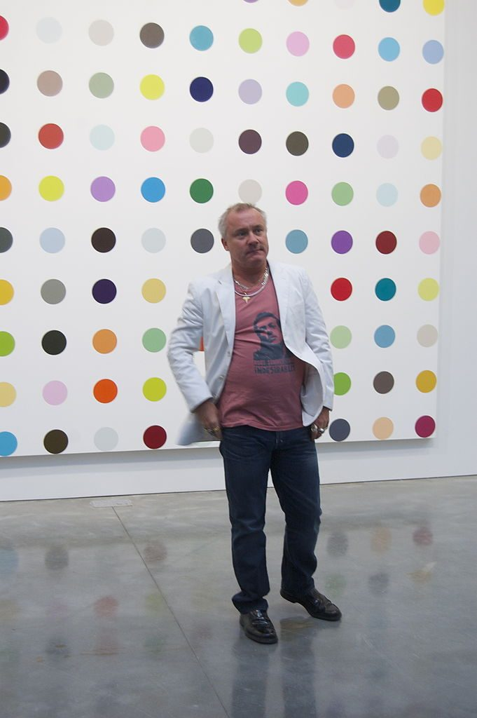 Damien Hirst at the exhibition Damien Hirst The Complete Spot Paintings 1986-2011, Gagosian Gallery, NYC. | Photo by Andrew Russeth/WikiCommons