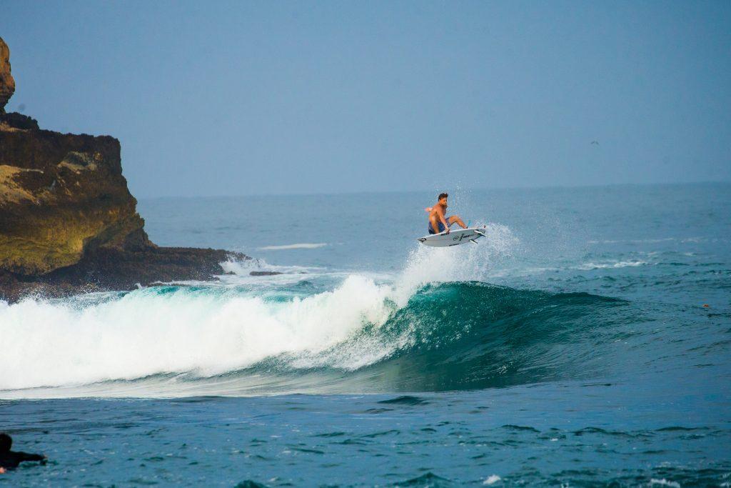 Harry Timson getting air off the coast of Java, Indonesia. | © Luke Forgay/Volcom