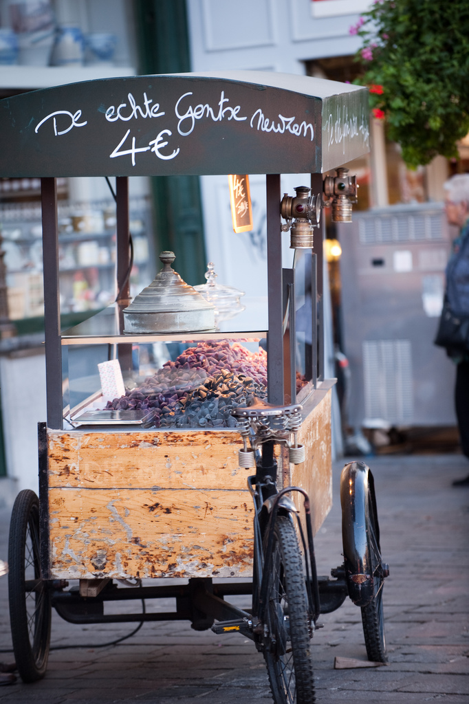 "One of two cuberdon carts competing for the tourist's attention. The line on top reads 'The real Ghent ""neuzekes""' 
