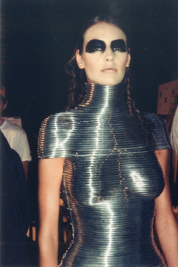 Backstage at the Alexander McQueen 'Black' show, June 2004. Aluminium Coiled Corset by Shaun Leane for Alexander McQueen, The Overlook, Autumn/Winter 1999 | Courtesy of the Shaun Leane archive