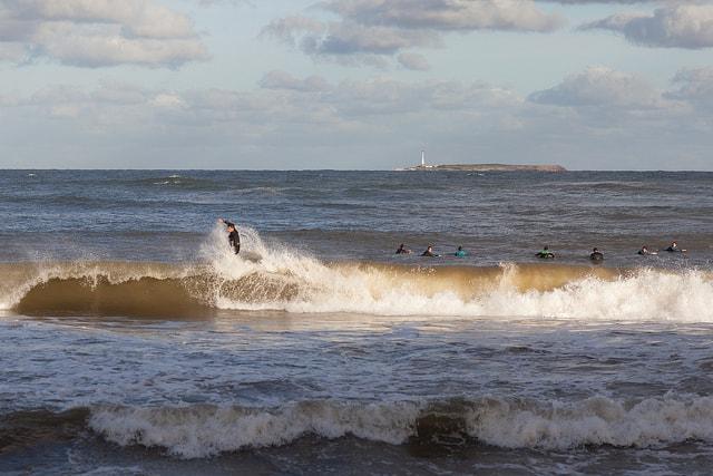 Surfers at El Emir beach, Punta del Este, Maldonado, Uruguay
