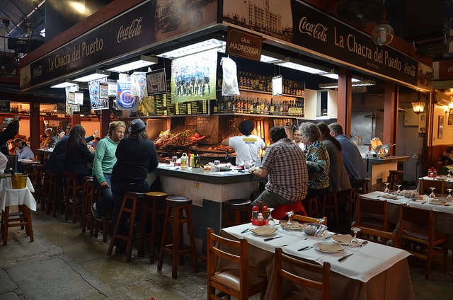 People eating at Mercado del Puerto, Montevideo, Uruguay