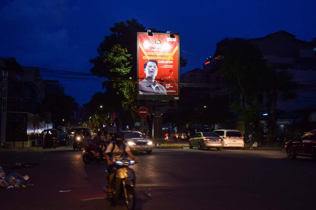 Poster of Ouk Sreymom above the Phnom Penh traffic | © Pete Ford