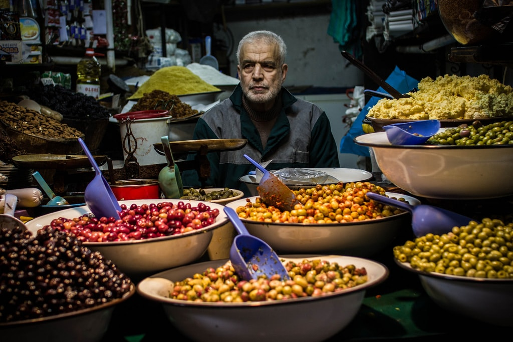 Olive vendor at a market in Morocco | © Christopher L. / Flickr