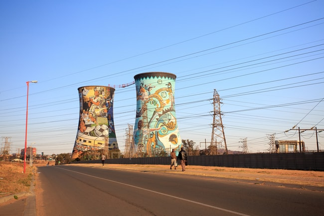 The famous graffitied cooling towers of Soweto, Johannesburg | © Gil.K/Shutterstock