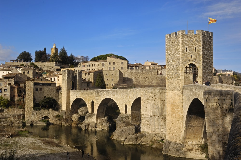 Medieval bridge of Besalú, Spain | © Josep Curto/Shutterstock