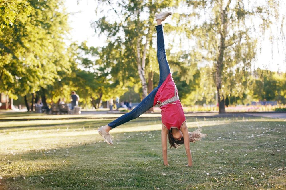 Cartwheel in the Park   © Kseniia Vorobeva/Shutterstock