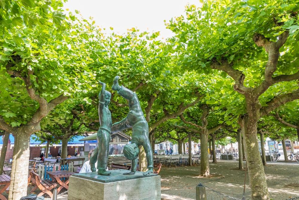 Cartwheelers statue at Burgplatz in Dusseldorf, Germany   © Takashi Images/Shutterstock