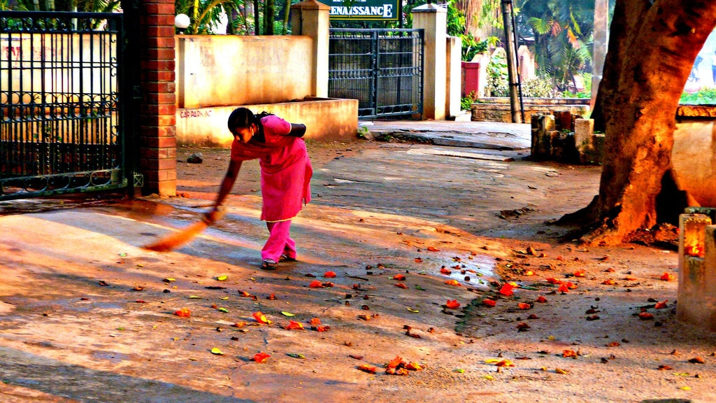 A woman sweeping