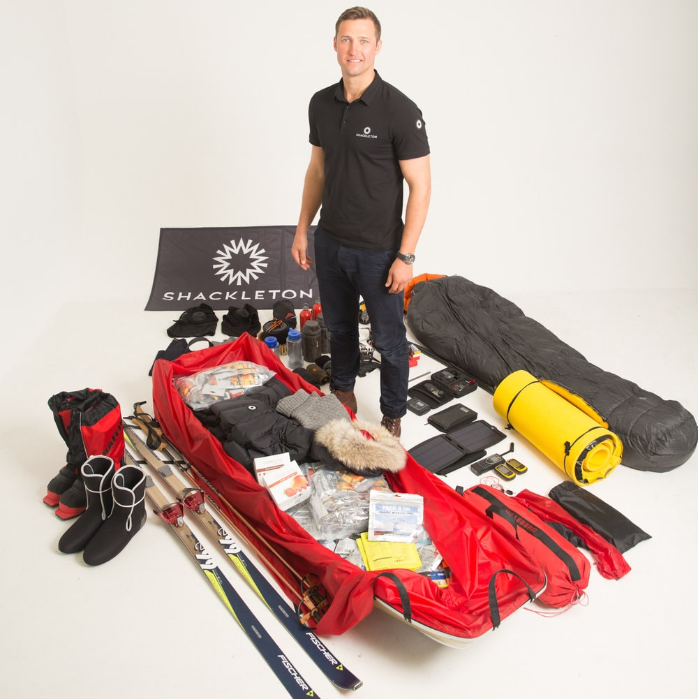 Scott with his sled and all the equipment he will carry on his expedition