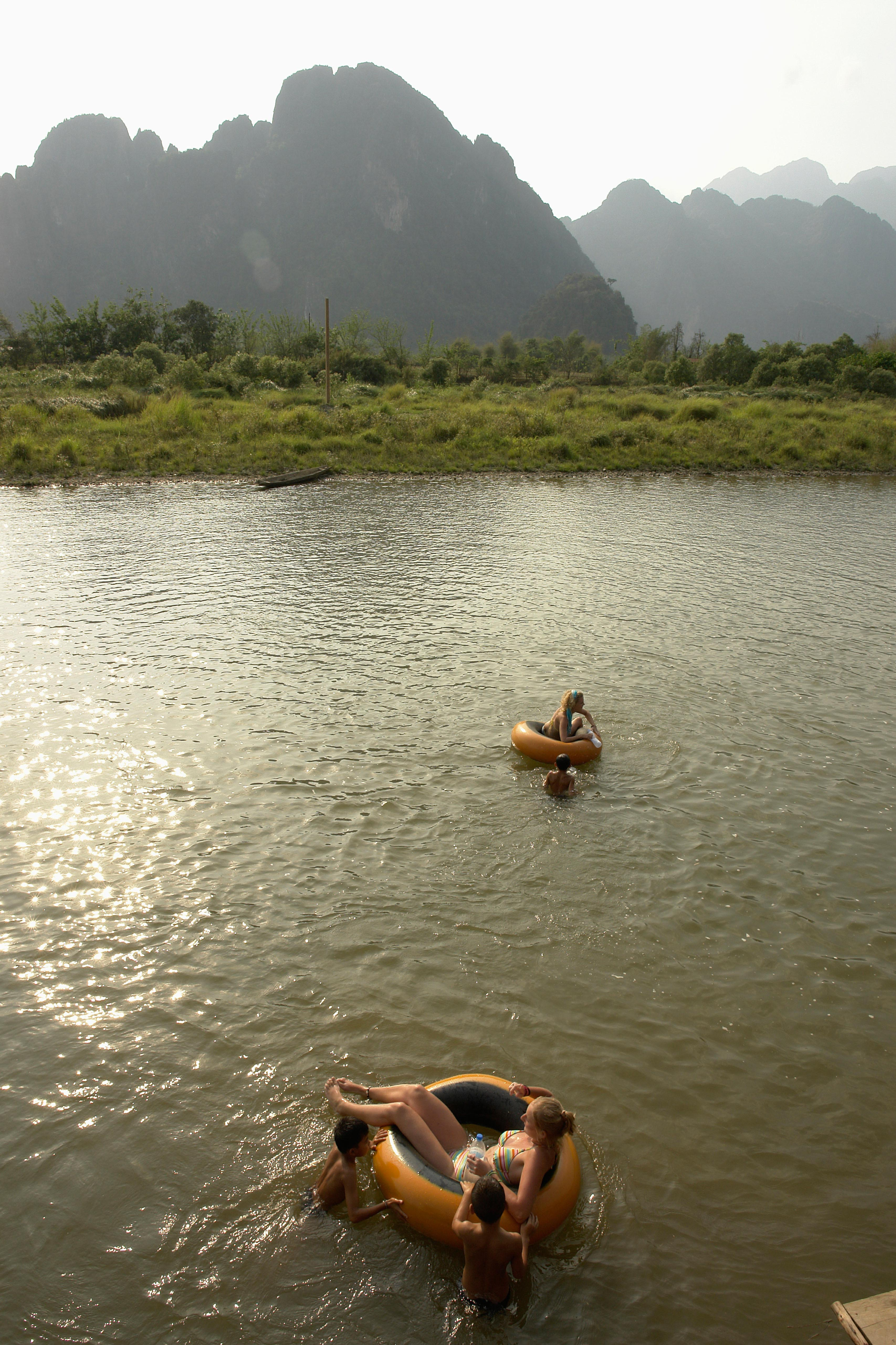 Painet jf5696 laos tourists tubing down nam ngung river vang vieng asia se transport tourism country developing nation less