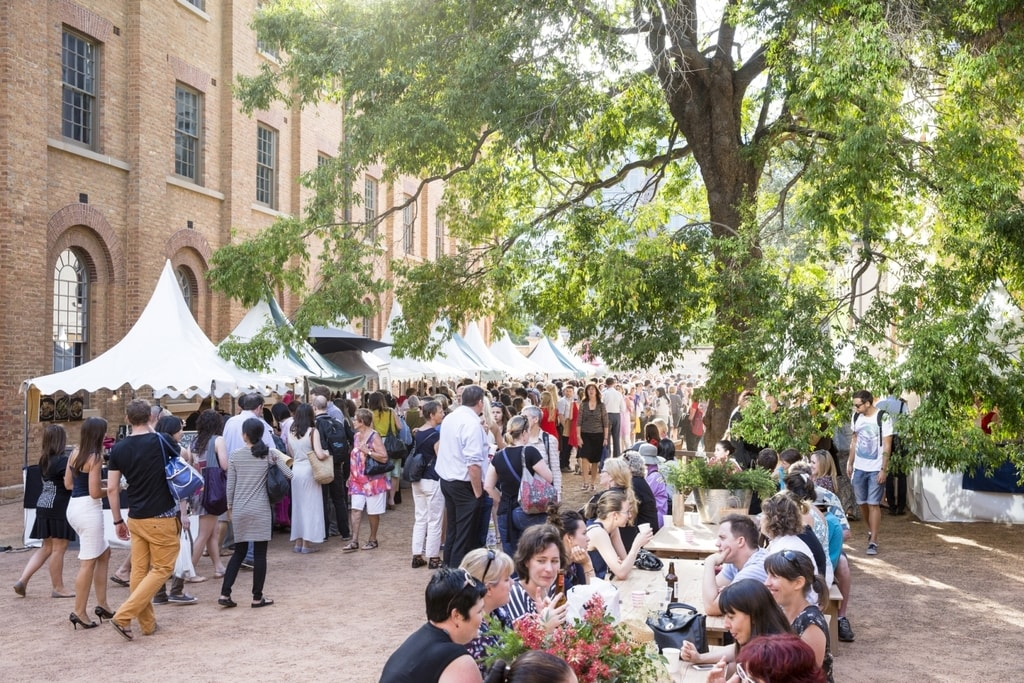 Visitors and stalls at the Christmas Markets, Hyde Park Barracks Museum