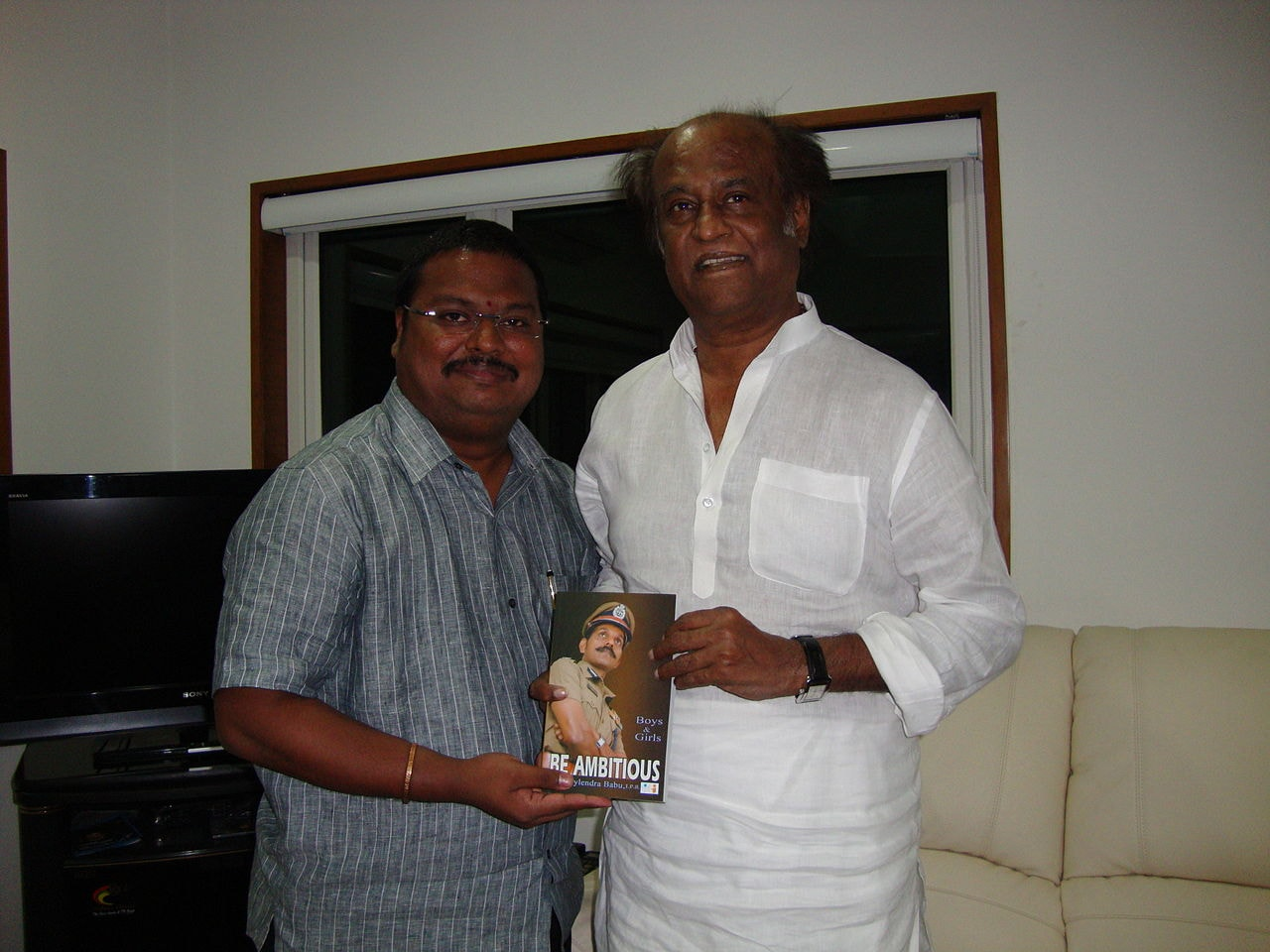 1280px-Suresh_Prthasarathy_with_rajinikanth_sir