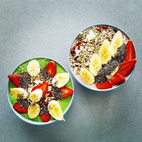 Green goodness smoothie bowl on the left, strawberries and cream on the right | Courtesy of Eat Drink Raw