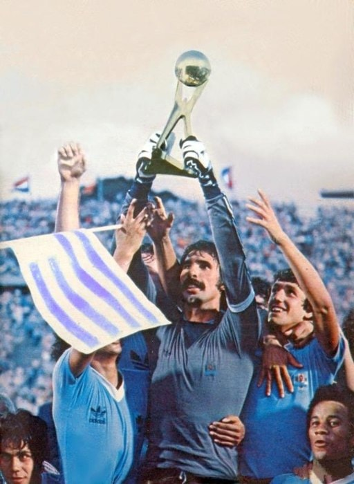 An illustration of Uruguayan players holding the World Champions' Gold Cup trophy