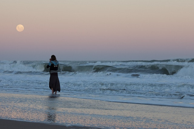 A woman on a Uruguayan beach at twilight