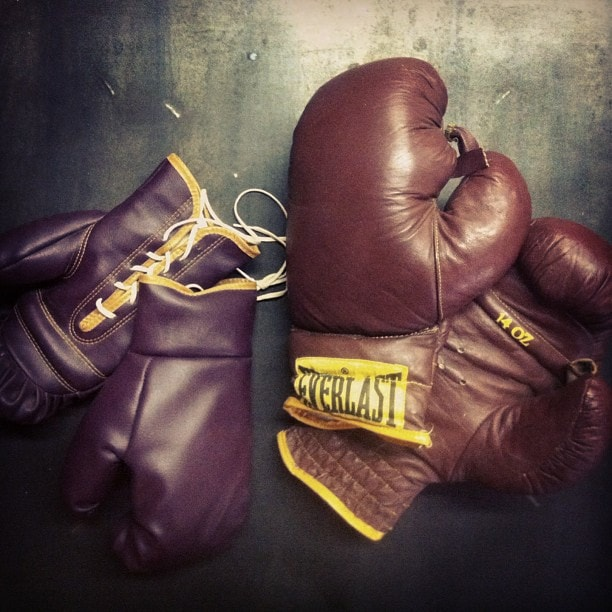 Two pairs of vintage boxing gloves